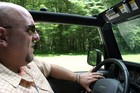 Jim driving -- a frequent activity of his.